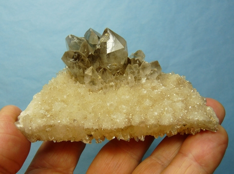 Light smoky quartz crystal s and very small quartz clusters on matrix