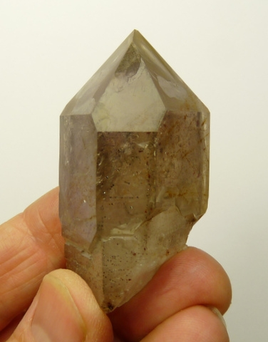 Hematite included quartz crystal