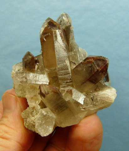 Quartz crystal group with schorl needles inside and on them