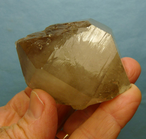 Double terminated quartz crystal with a faint smoky colouring