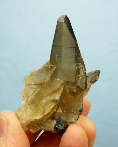 Group of smoky quartz specimen with schorl and feldspar