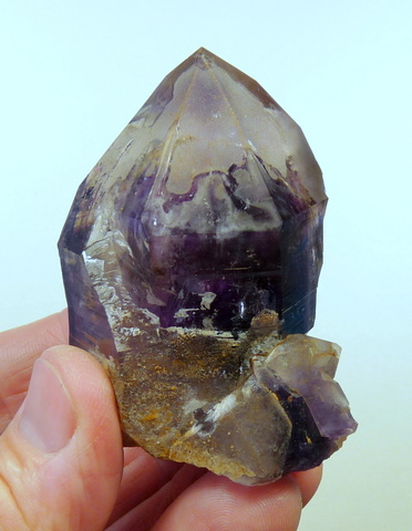 Amethyst quartz crystal with patches of chalcedony