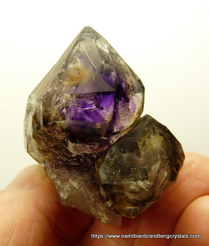 Clear quartz cluster, with faint amethyst colour inclusions