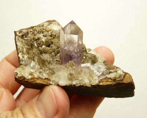 Quartz crystal with light amethyst colouring, on matrix
