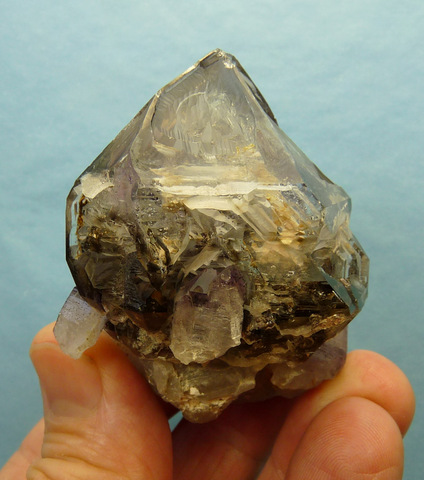 Stubby quartz crystal with light smoky colour and interesting shape