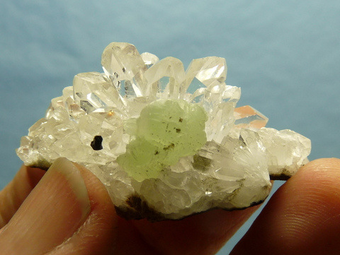 Gemmy, clear quartz crystal with layer of (?)epidote under surface
