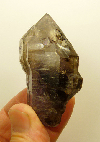 Beautiful quartz crystal with faint amethyst colour and moving bubbles