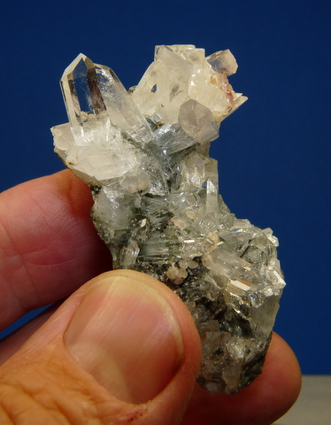 Quartz and calcite cluster on matrix, with traces of epidote