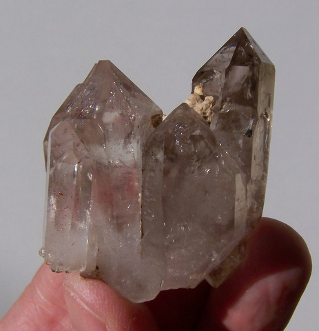 Lovely, gemmy group of quartz crystals, ranging in colour from clear to light smoky.