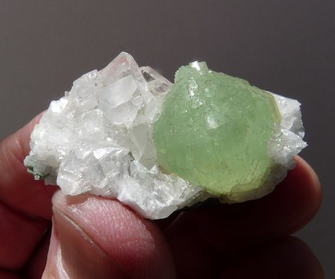 Lovely prehnite ball on calcite crystals, on matrix