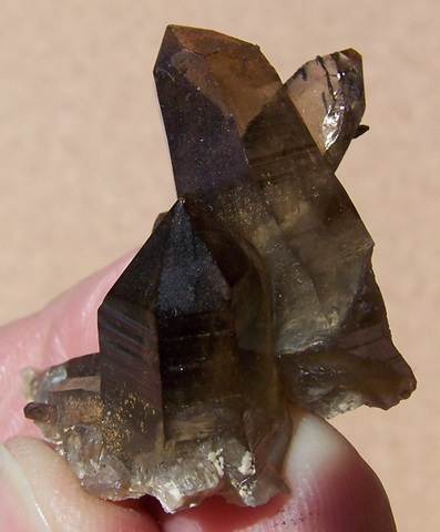 Smoky quartz crystal group with inclusions of schorl crystals