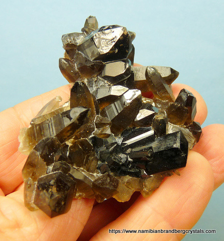 Topaz crystal and schorl crystals on feldspar matrix
