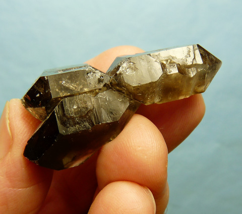 Smoky quartz crystal group with interesting growth patterns and facets