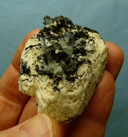 Aquamarine and schorl crystals on feldspar matrix