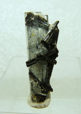 Aquamarine crystal with schorl on and inside it