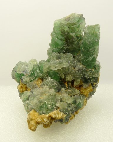 Green fluorite crystal group with mica