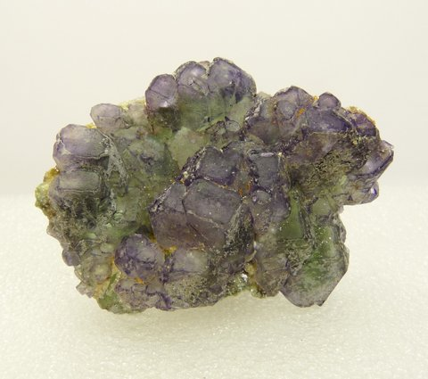 2-sided fluorite crystal group with hyalite opal