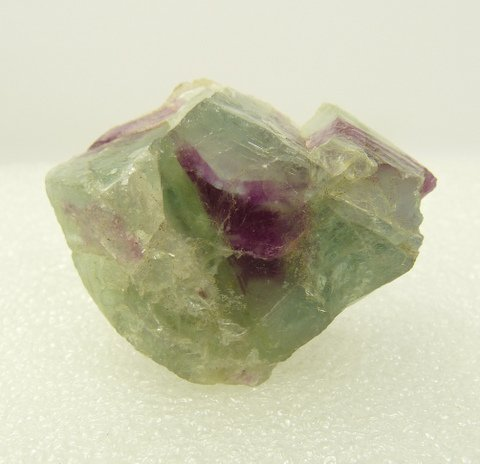 Piece of fluorite with blueish-green and purple colouring