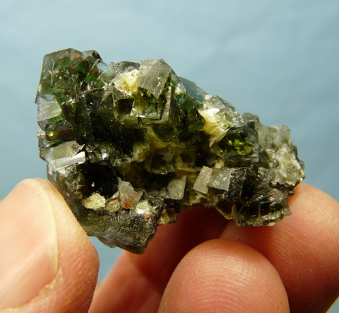 Fluorite crystal group with bits of mica