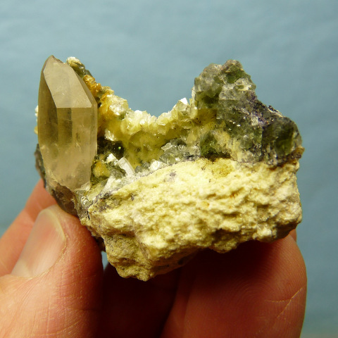 Small group of green fluorite crystals with mica, schorl, and feldspar