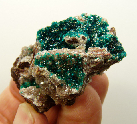 Small dioptase and calcite crystals on matrix