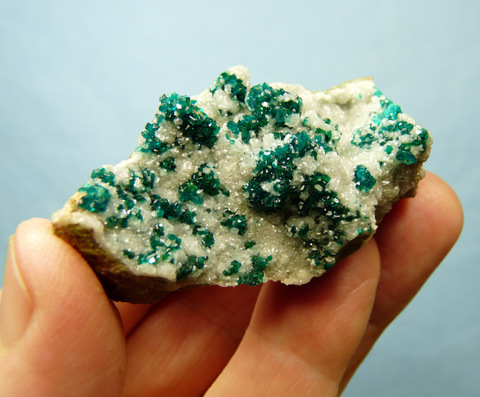 Small dioptase crystals on small, drusy, pearly calcite crystals, on matrix
