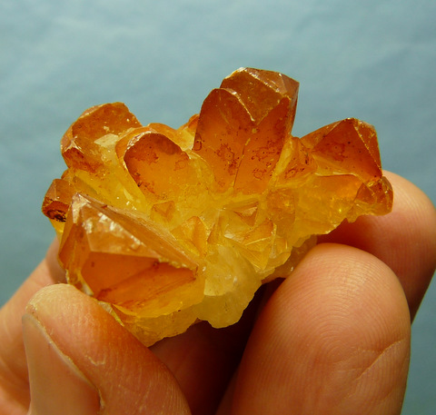Calcite crystal group with orangy coating