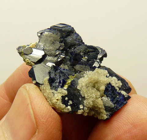 Azurite crystals with an unknown mineral attached