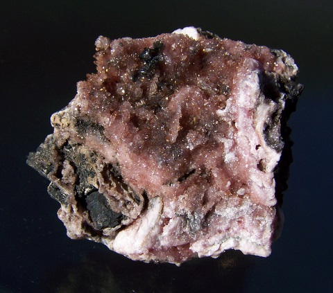 Gemmy, sparkling rhodochrosite crystals on rhodochrosite and manganite matrix