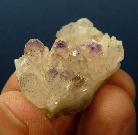 Quartz crystal group with amethyst phantoms