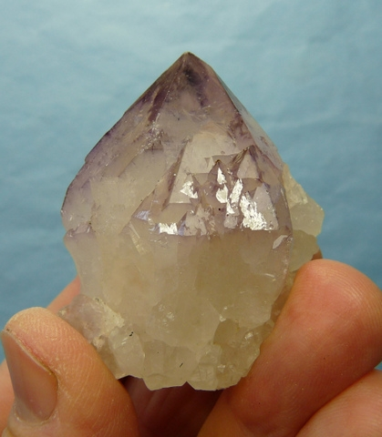 Complex quartz crystal with bits of amethyst and smoky colouring