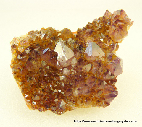 Amethyst quartz crystals with some yellow colouring, on matrix