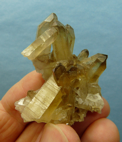 Pale green fluorite crystals on quartz crystal cluster