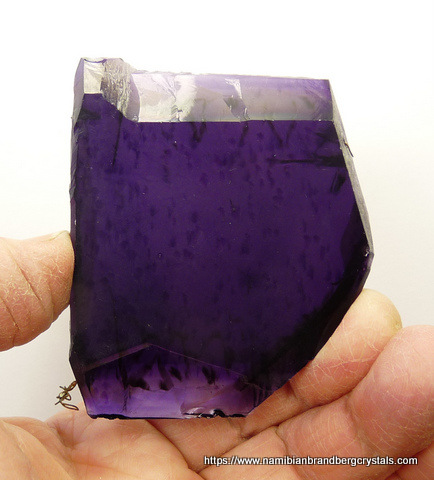 Slab of rock with sugilite, one side polished