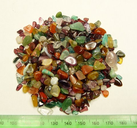 Sixty five grams of colourful, mixed tumbled stones