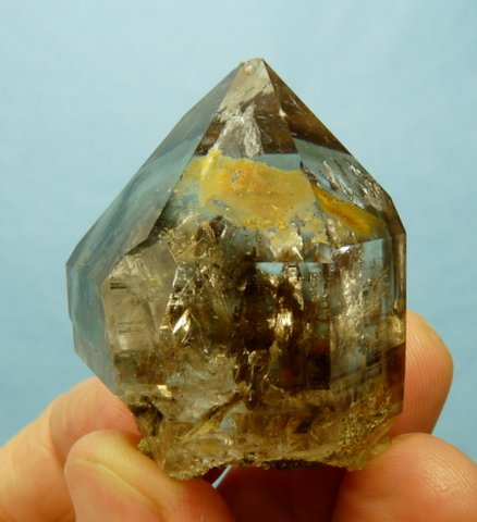 Stubby crystal with smoky patches and crystal inclusions